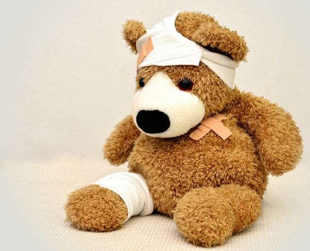 brown-and-white-bear-plush-toy